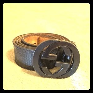 Gucci all black belt with Gucci lettering on belt